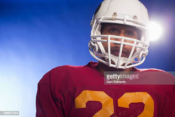 Close up of football player wearing helmet