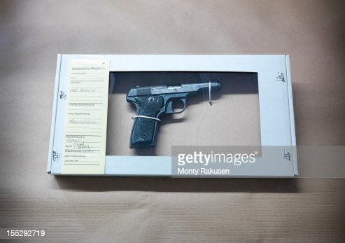 Close up of forensic science evidence box containing gun from crime scene : Stock-Foto