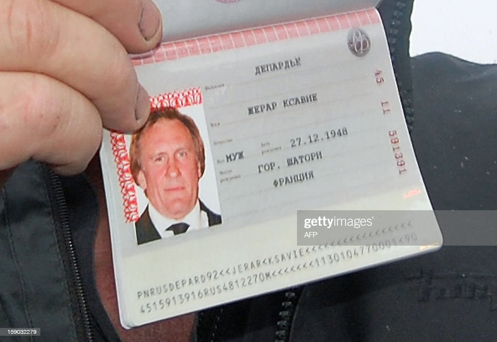 A close up of French actor Gerard Depardieu, who has threatened to quit his homeland to avoid higher taxes, showing off his new Russian passport on January 6, 2013 at Mordovia airport in Saransk where he has been offered residence in this central Russia region known for Stalin-era Gulag labour camps. The former Oscar nominee travelled to snow-covered Mordovia a day after he met with strongman President Vladimir Putin at his sumptuous Black Sea villa in the resort town of Sochi for friendly banter over a meal. AFP PHOTO / CAROLINE LARSON