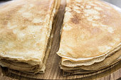 Close up of french crepes, thin pancakes on a wooden board.