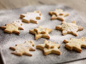 Close up of freshly baked christmas biscuits on baking tray