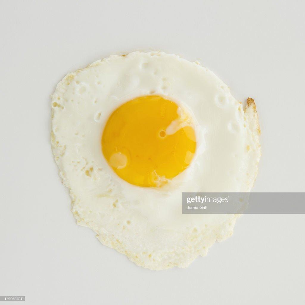 Close up of fried egg, studio shot