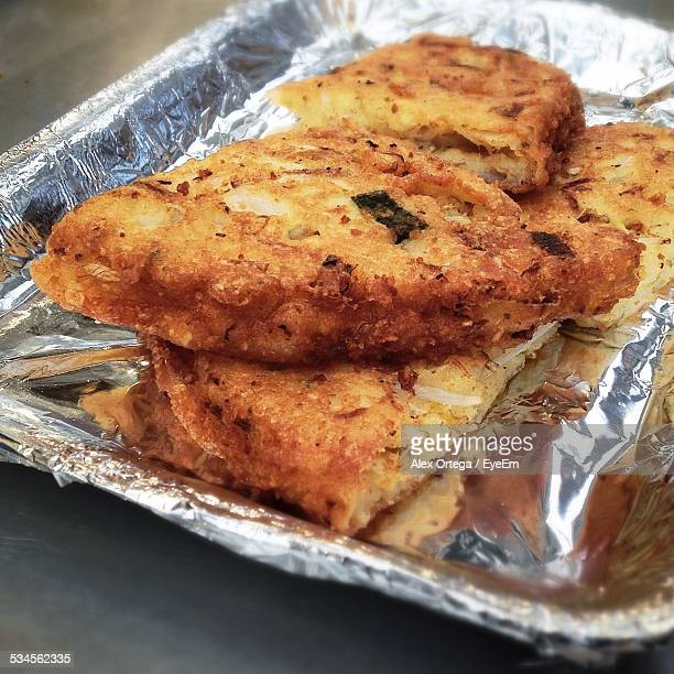 Close Up Of Fried Food On Aluminum Tray