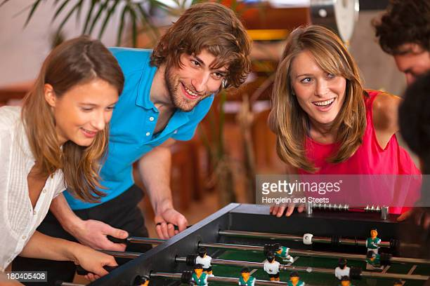 Close up of friends having fun playing table football