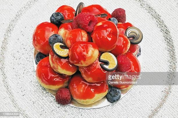 Close up of fruit profiterole cake