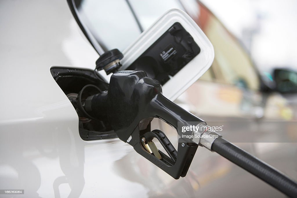 Close up of gas nozzle in tank