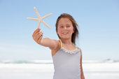 Close up of girl holding starfish