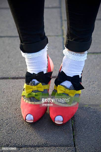 Close up of girl wearing bows on shoes
