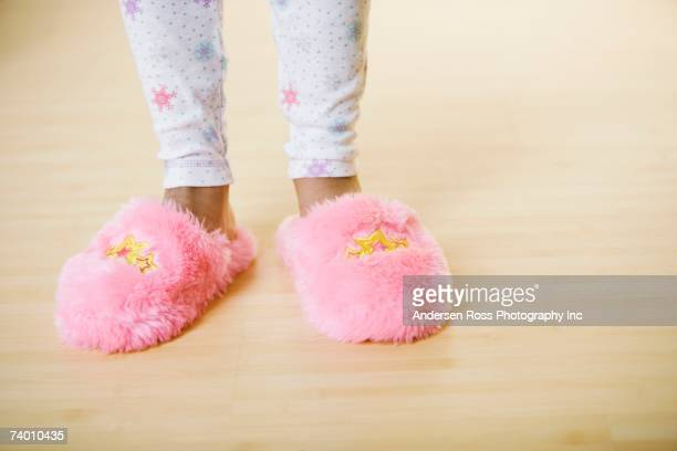 Close up of girl wearing slippers