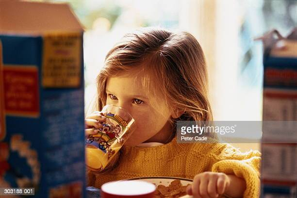 Close up of girl(4)in yellow sweater having breakfast