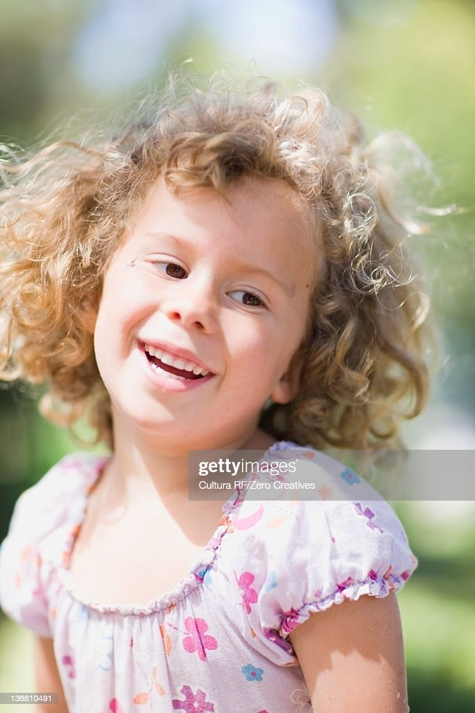 Close up of girls smiling face outdoors : Stock Photo