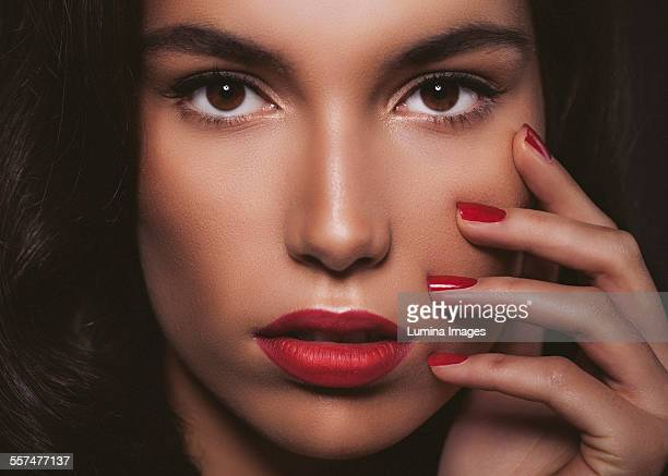 Close up of glamorous woman touching her face
