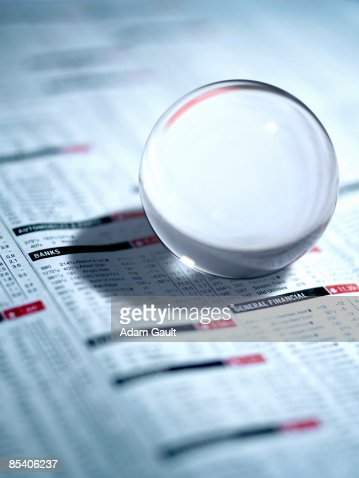 Close up of glass ball on newspaper : Stock Photo