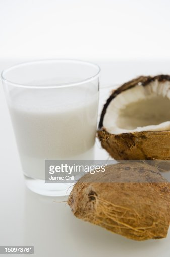 Close up of glass of milk and coconut fruit