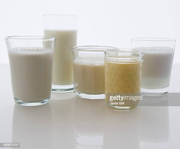 Close up of glasses with different kinds of milk