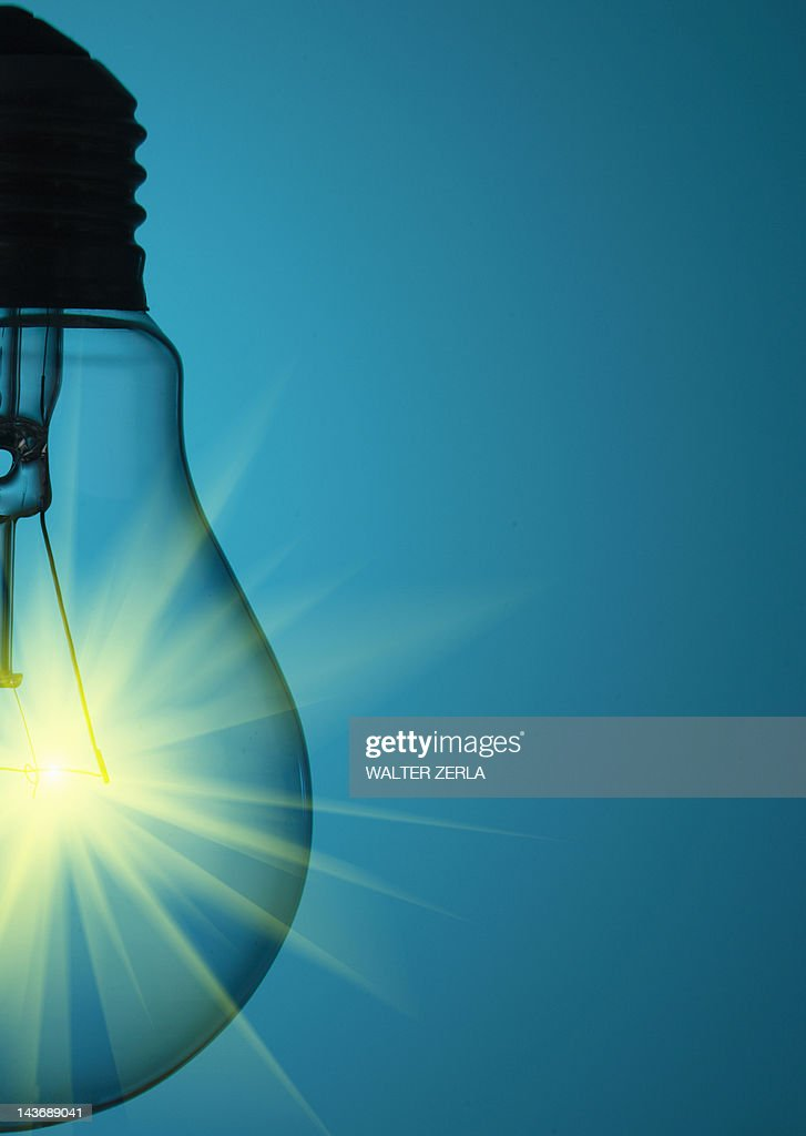 Close up of glowing light bulb : Stock Photo