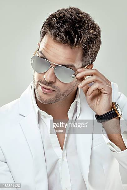 close up of good looking man wearing sunglasses