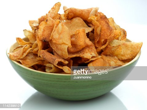 Close Up of Green Bowl Full of Potato Chips