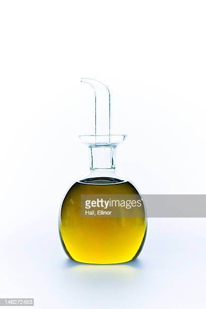 Close up of green lemonade in carafe on white background