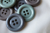 Close up of grey buttons