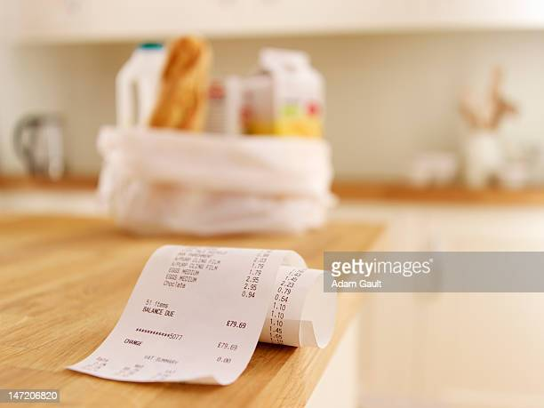 Close up of grocery receipt on kitchen counter