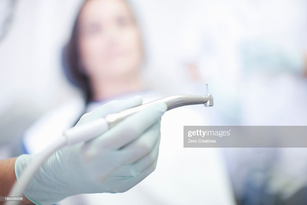 Close up of hand holding dentist drill