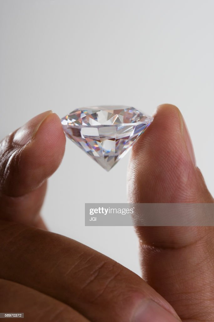 Close up of hand holding diamond : Stock Photo