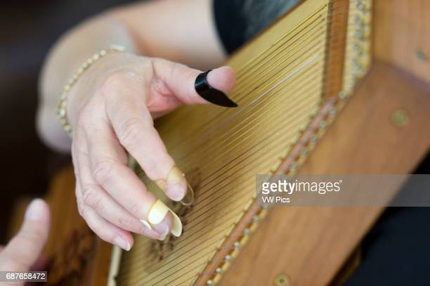 Close up of hand playing autoharp