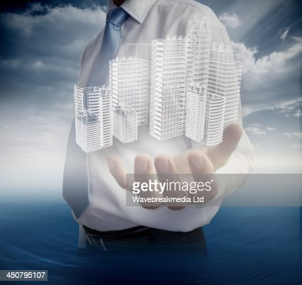 Close up of hand showing faint holographic city : Stock Photo