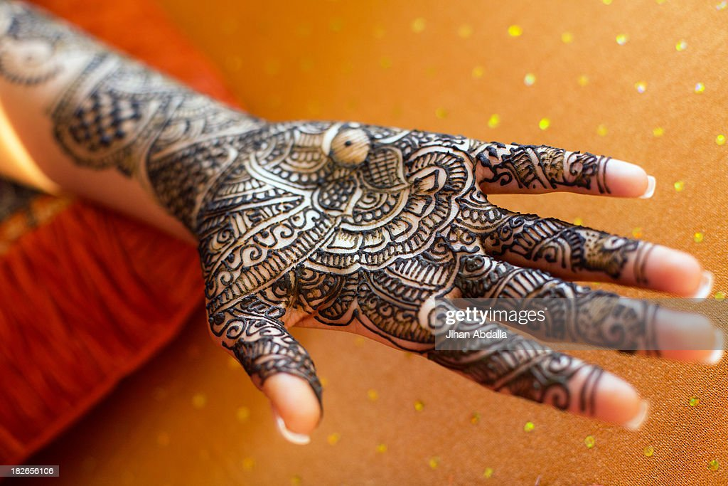Close up of hand with intricate henna design : Stock Photo