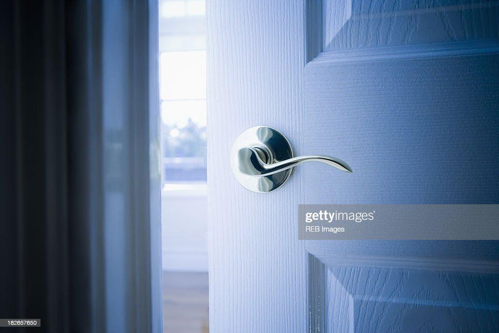 Close up of handle on open door