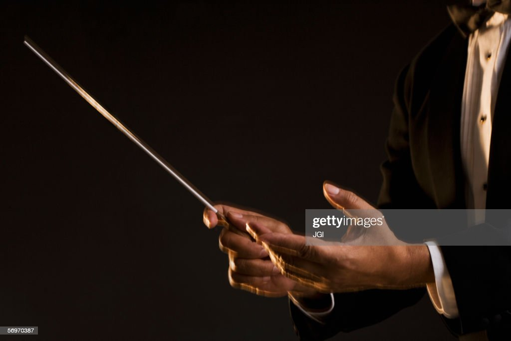 Close up of hands conducting
