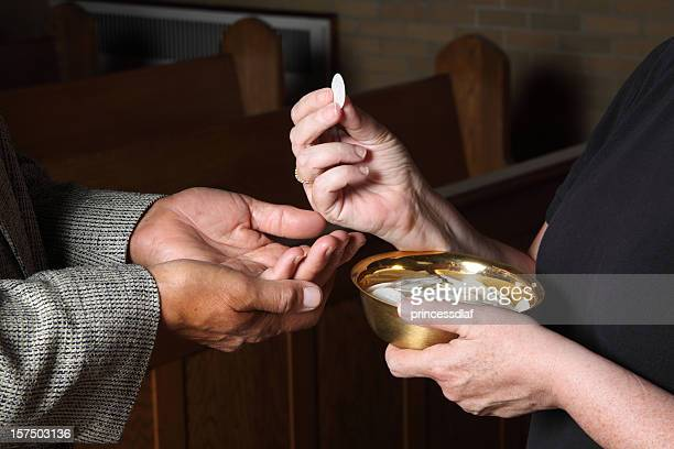 Close up of hands giving Communion