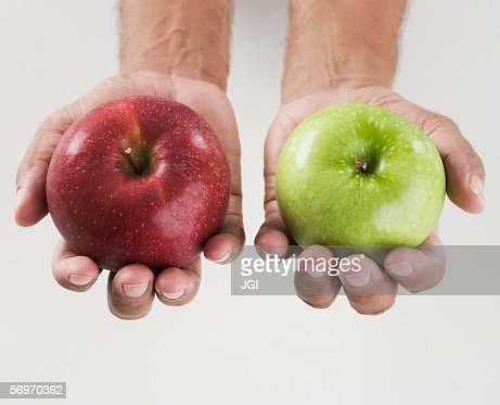 Close up of hands holding two apples