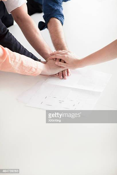 Close up of hands of business people on top of each other in partnership