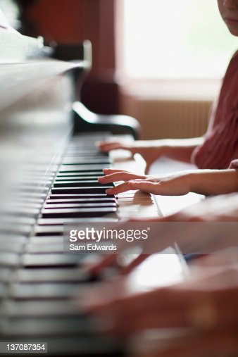Close up of hands on piano : Stock Photo
