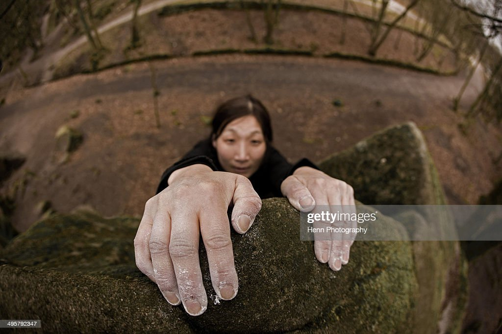 close up of hands on top of a bouldering problem at the Peak district / UK