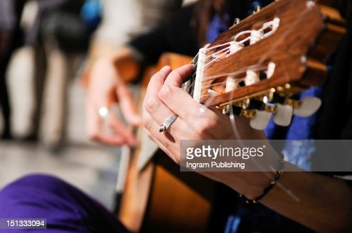 Close up of hands playing a guitar. : Stock-Foto