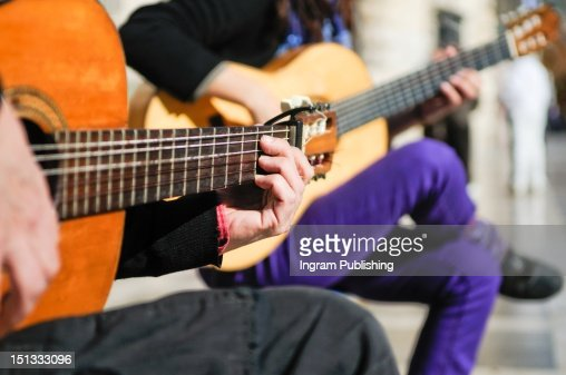 Close up of hands playing a guitar. : Foto stock