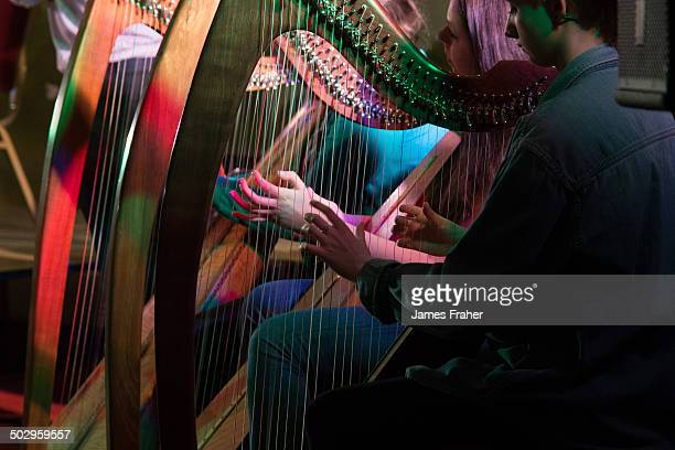 A close up of hands playing the harp at an Irish music concert at the Fleadh Gathering concert at the Southern Hotel on May 17 2014 in Sligo Ireland