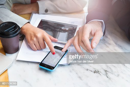 Close up of hands with financial chart on phone.on : Stock Photo