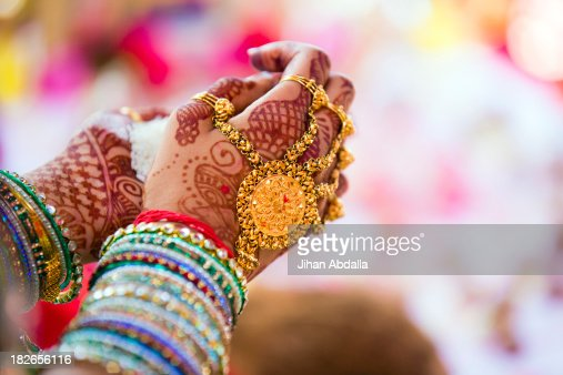 Close up of hands with intricate henna design : Stock Photo