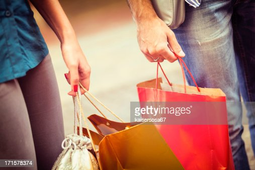 Close up of hands with shopping bags
