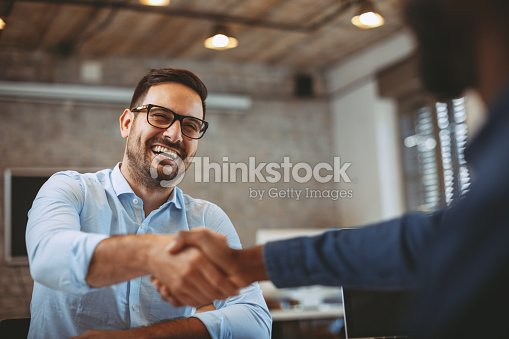 Close up of handshake in the office : Foto stock