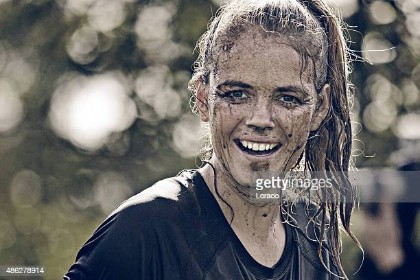 close up of happy woman covered by mud