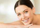beauty, people and relaxation concept - close up of happy woman in spa
