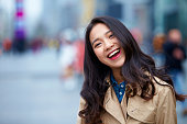 happy young asian woman close up