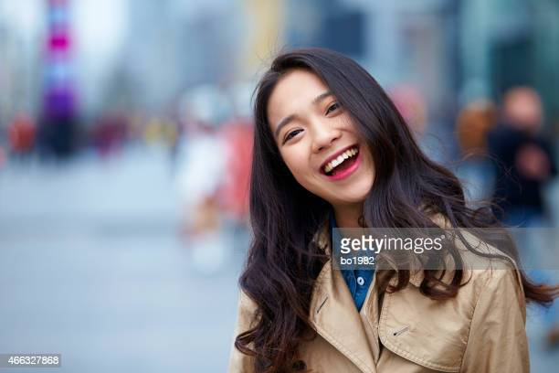 close  up of happy young asian woman