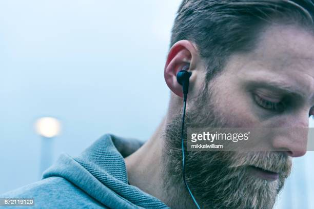 Close up of headset worn by a man with beard