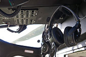 Close Up Of Headsets In Helicopter Cockpit